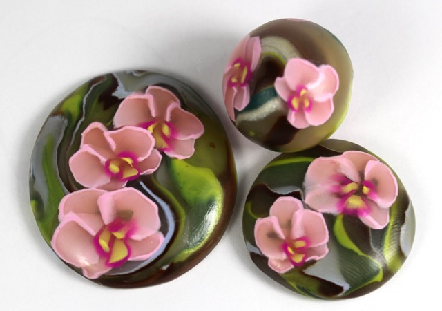 Polymer clay orchid cane cabochon
